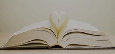 Book with pages in heart